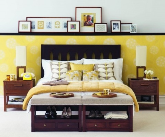 a redwood mid century modern bed with storage units at the food of the bed and matching nightstands