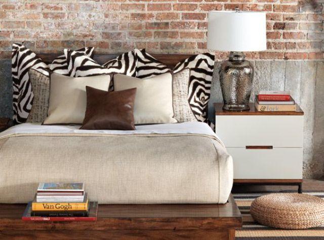 a rich stained mid century modern bed and two white and stained nightstands give an elegant feel to the space