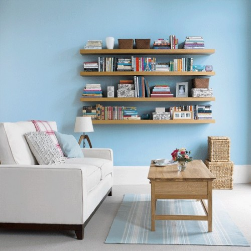 IKEA Lack are probably the cheapest floating shelves you could hang in your living room. They come in different sizes and are perfect to display your books and other treasures.
