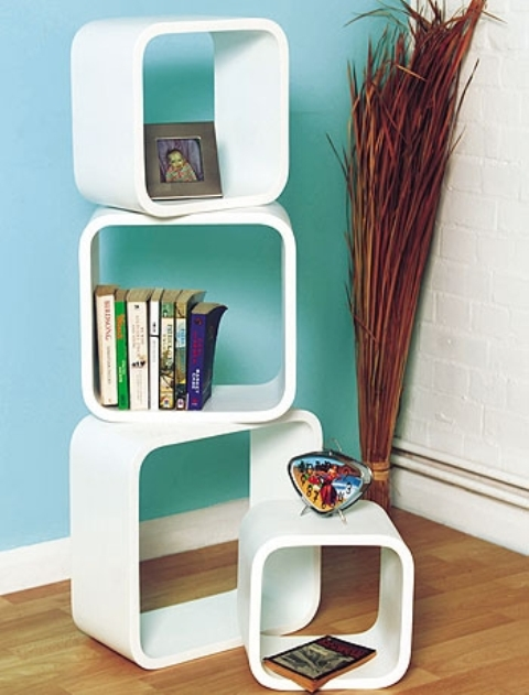 Stylish free-standing shelves might not be as effective for storage as large bookcases but they can make your living room looks less boring and more cool.