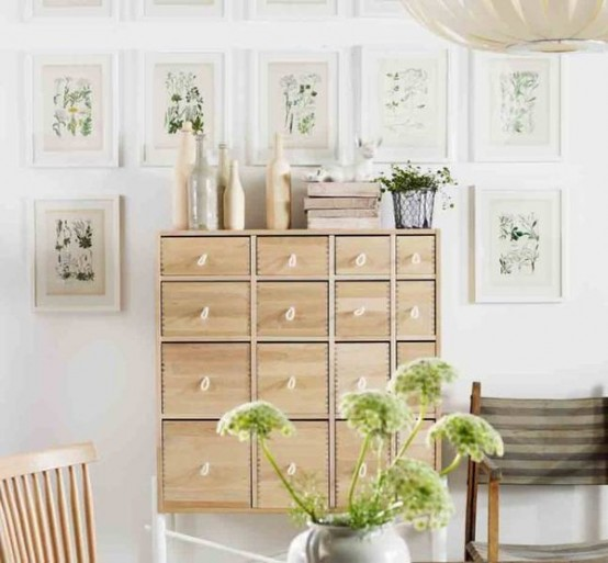 A wall-mounted chest of drawers won't occupy much space but would provide lots of concealed storage space. Lots of stuff could fit in such storage unit.