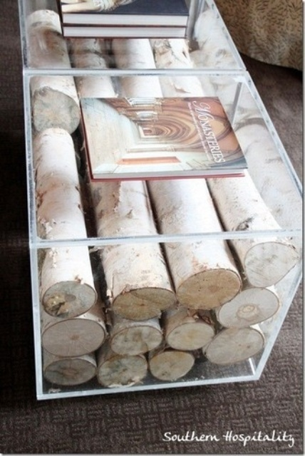 In case you don't want to use a tiered coffee table to store such things as books and magazines here is a nice decor idea for you. Put some wood logs in it. Even if there is no fireplace in your living room and you don't need to store firewood such table would add a cozy touch to the room's decor.