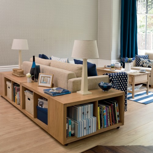 Cabinets around the sofa is a smart way to use the space if you have an open-plan living room.