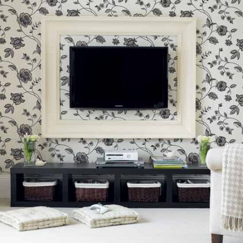 Here is a cool idea to enhance wall-mount TV's look. Frame it in bold mouldings to help it looks more harmonious with surroundings.