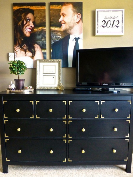 Changing knobs and adding some metal decor turn a plain black dresser into a stylish storage solution for a living room.