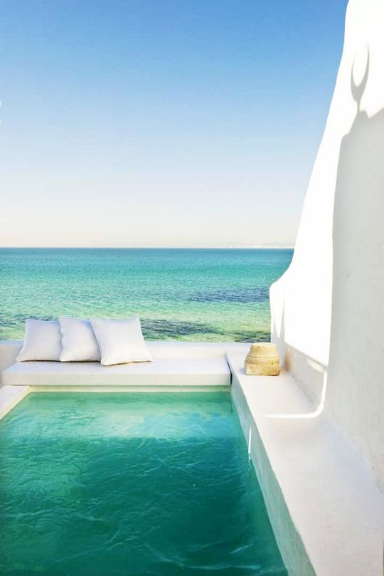 small Grecian-styled terrace with a plunge pool