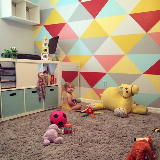 Small And Bold Kids Playroom With A Bold Geo Wall