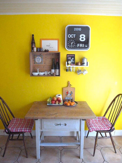 Small And Cozy Dining Area With Yellow Wall