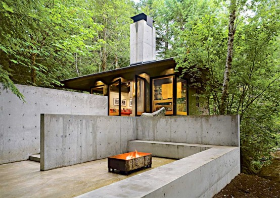 Small And Natural House Design On A River