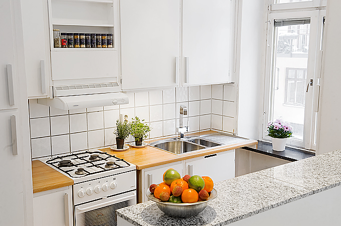Small and thoughtful swedish apartment interior design digsdigs for Interior design for small kitchen