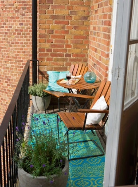 57 cool small balcony design ideas digsdigs for Apartment porch decorating ideas