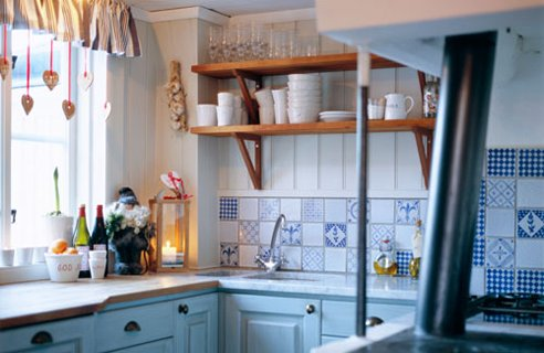 Small Country Kitchen With Cute Cutter On Shelves