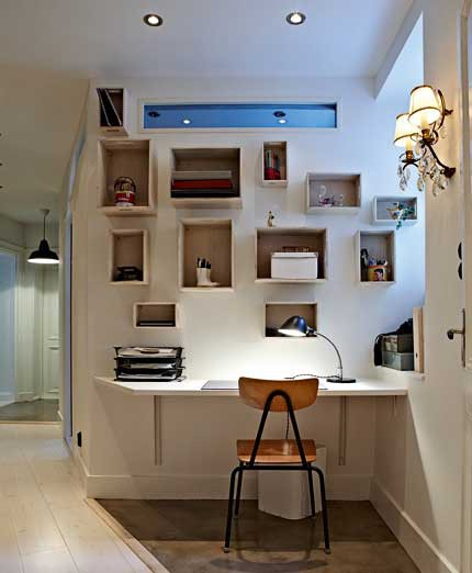 Even in a hallway you could organize a cozy working area with lots of storage.