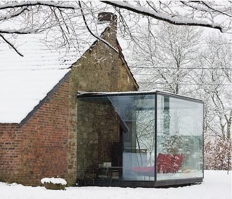 Small yet cozy sunroom house extension. Perfect little nook to enjoy winter weather in warmness.