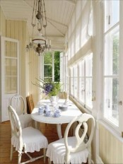 a vintage-inspired sunroom nook with a tea space with sophisticated furniture and vintage lamps