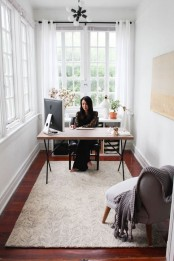 a sunroom turned into a home office guarantees much fresh air, sunshine and inspiration for work