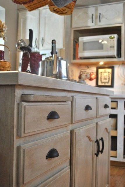 a whitewashed cabinet for a modern or farmhouse kitchen is a lovely idea   just whitewash your own stained cabinet and voila