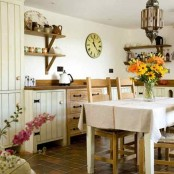 whitewashed kitchen cabinetry is a lovely idea for a farmhouse or rustic space, and it looks simple and very cool