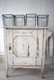 a shabby chic whitewashed cabinet is a lovely and relaxed idea for a shabby chic or vintage space
