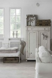 a whitewashed cabinet is a stylish idea for a Scandinavian, shabby chic or just vintage interior and it looks very cool