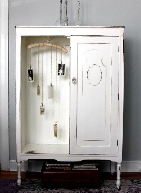a vintage whitewashed storage unit with a door and an open storage compartment with decor is a very cool and lovely idea