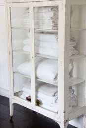 a whitewashed glass wardrobe with lots of shelves is a great solution for a bathroom with a slight vintage feel, and it will display anything else you want
