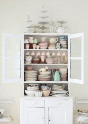 a whitewashed cupboard is always a great idea for a vintage or shabby chic space and it will make your dining room or kitchen more refined