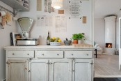 a vintage whitewashed kitchen cabinet like this one is a great idea for a vintage or shabby chic space and it looks rather lightweight