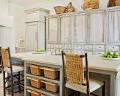 a whole arrangement of vintage whitewashed cabinets with upper parts of glass but with curtains are amazing to build up a vintage kitchen