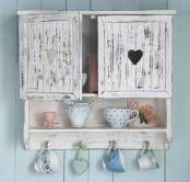 a vintage planked whitewashed cabinet with a closed and an open shelf is a lovely idea for a shabby chic kitchen and won't take much space