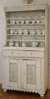 a vintage whitewashed cabinet with open shelves and a closed storage part is a lovely idea for a chic kitchen