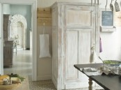 a pretty shabby chic whitewashed storage unit with a tassel is a cool solution for a shabby chic or rustic space
