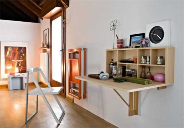 a folding mini desk or bar like that can be used and then hidden back, which is a great idea for a modern space
