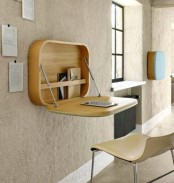 a plywood bureau or desk like this one will let you work, sign papers and do other simple stuff and then fold it back