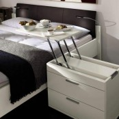 a white nightstand with an additional breakfast table that can be folded back is a perfect piece for a great morning