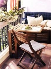 a wooden folding table and chair by IKEA will save space on your small balcony letting you enjoy fresh air at its best