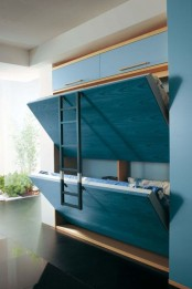 blue Murphy's beds with a ladder are a cool option for a small kids' room or guest bedroom