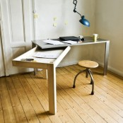 a desk with a foldable part that can be used for storage or for working or it is a creative option
