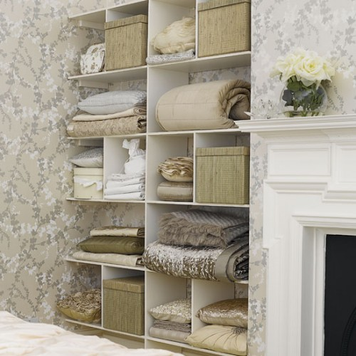 Even if your bedroom walls are covered with a wallpaper you can make built-ins blend in.