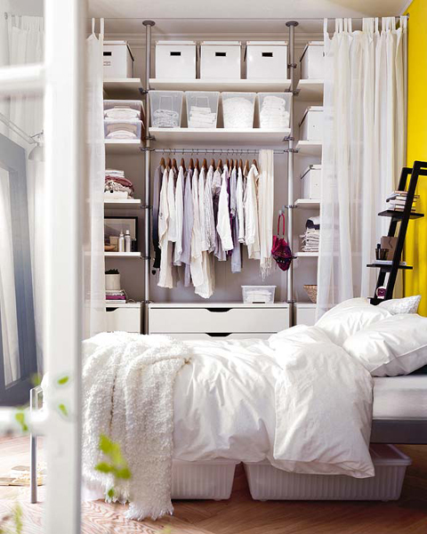 IKEA storage units allow you to create fully functional wardrobe that occupy any space you want. Just cover it with a curtain and it would be easy to access.