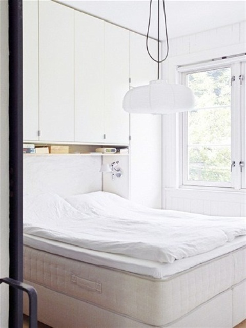 This is a super practical idea for a small bedroom storage. Every inch of space is effectively used.