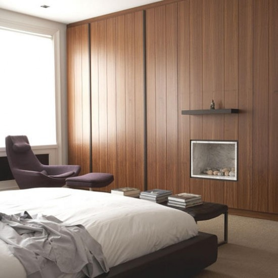 You can design a wardrobe to occupy the whole wall to make your room minimalist but with lots of storage space.