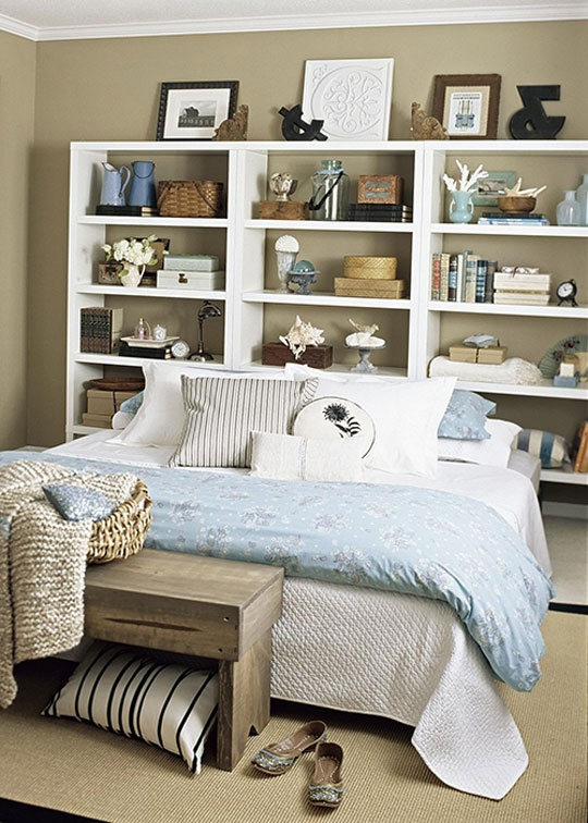 Even simple bookcases could be a practical solution that make the most of the space behind the bed.