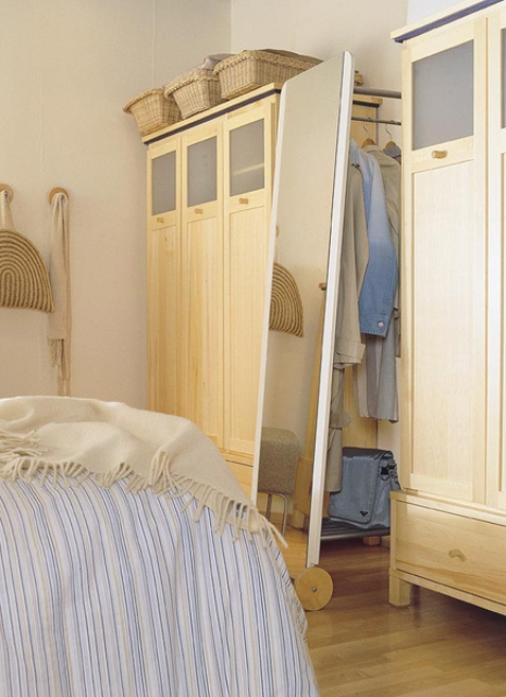 full size mirror could hide a coat rack that is easy to access