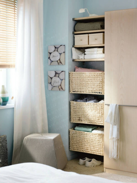If you have s free space that is to small for a wardrobe then install floating shelves there. They are perfect to display things on them but you can use them for storage baskets too.