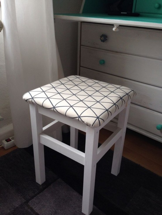 a white IKEA Oddvar stool upholstered with neutral printed fabric is a cool and fresh idea to use in any space