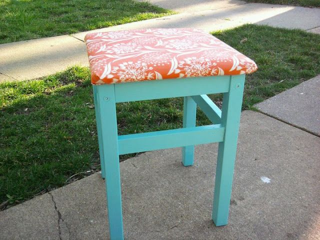 a turquoise IKEA Oddvar stool upholstered with bright coral printed fabric for a bold look