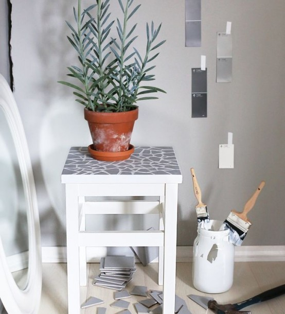 an IKEA Oddvar stool redone with grey tile shards on the seat may become a new plant stand in your home