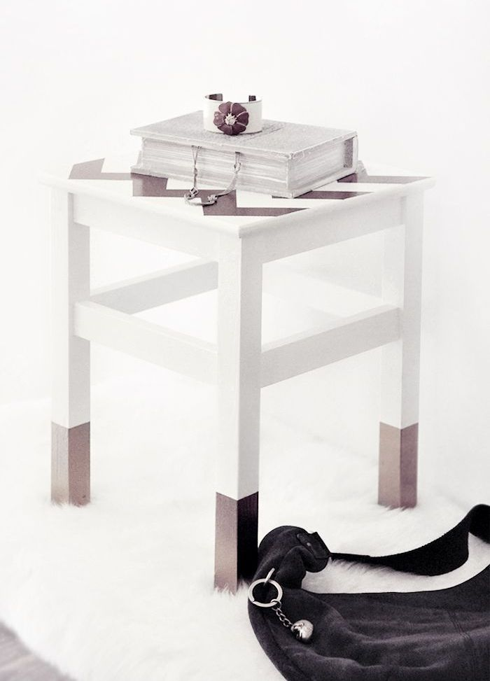 an IKEA Oddvar stool with paint dipped legs and a chevron painted seat can be used as a side table