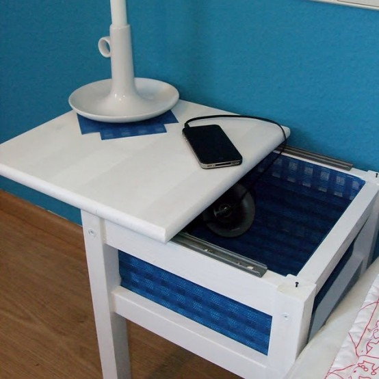 an IKEA Oddvar stool turned into a small nightstand with a box for storage under the top